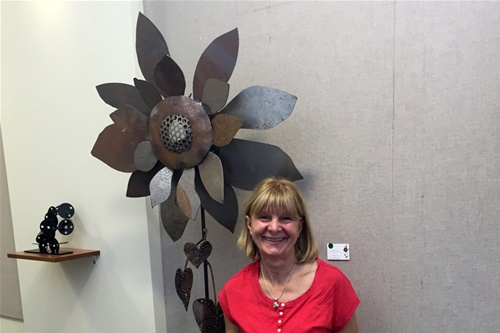 Sunflower sculpture by Laura Lavan and Millie Radonjic-Ilich in Larchmont Library at art exhibit